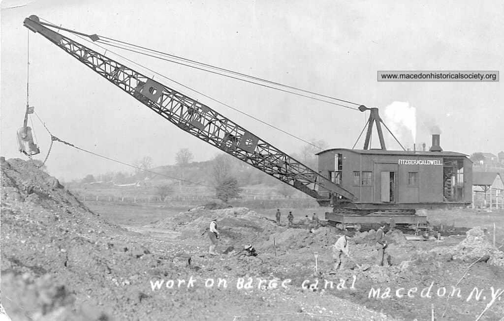 A steam powered dragline excavating for the Barge Canal.
