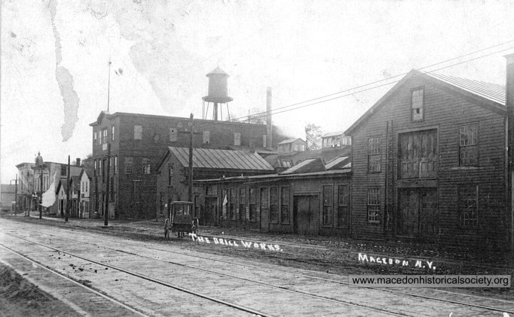 An old postcard showing the front of the Drill Works