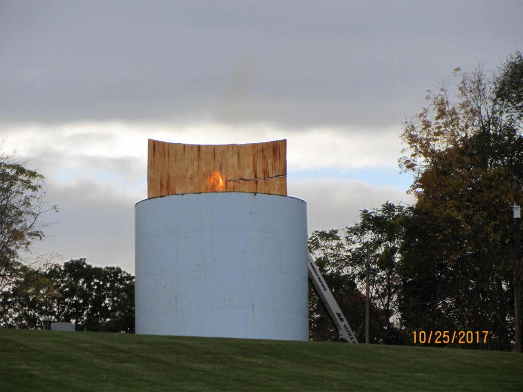 view of a section of the water tank being cut.